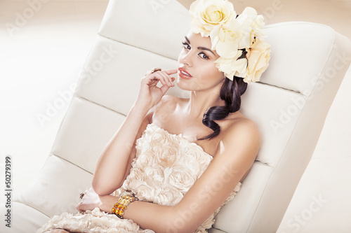 Pretty brunette woman with fabulous flower hat