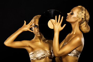 Women holding Vinyl Record. Fantastic Gold Badyart. Performance