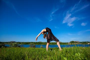 Beautiful dancer posing on planair