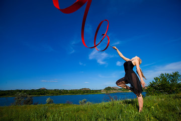 young gymnast  with a ribbon outdoor