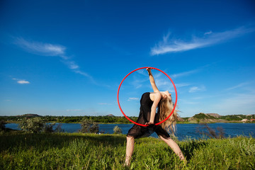 Young beautiful gymnast  with hoop