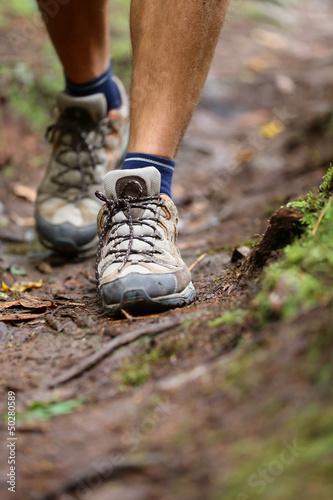 Hiker - hiking shoes closeup from hike walk