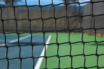 Tennis Court Net with the Court Beyond