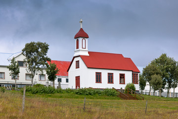 Rural Icelandic church at bad weather