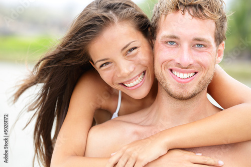 Beach couple - young happy couple portrait