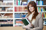 female student girl with books in library