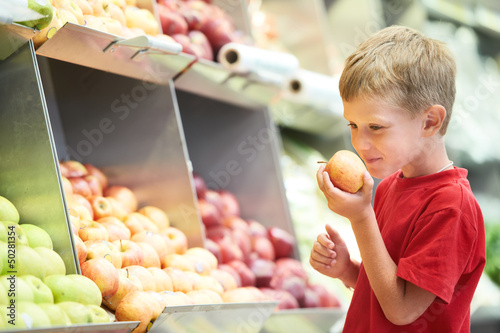 child boy choosing fruits vegetable shopping
