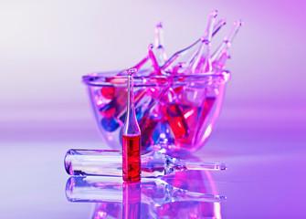 Medical ampoules still life in vivid violet colors