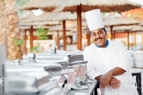 arab chef with food at restaurant hotel