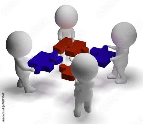 Jigsaw Pieces Being Joined Showing Teamwork And Assembling