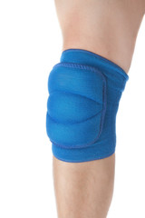 Knee protection in games on the male leg. Close-up. On a white b