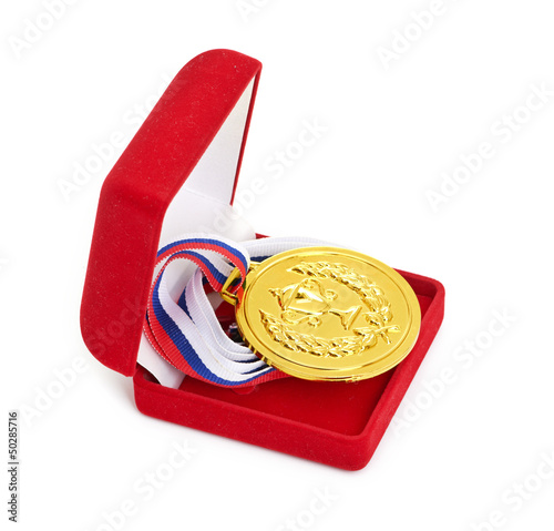 Golden medal in red gift box.