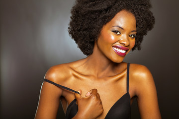 happy african american girl in black bra