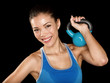 Fitness cross fit woman holding kettlebell