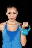 Fitness exercise crossfit woman holding kettlebell