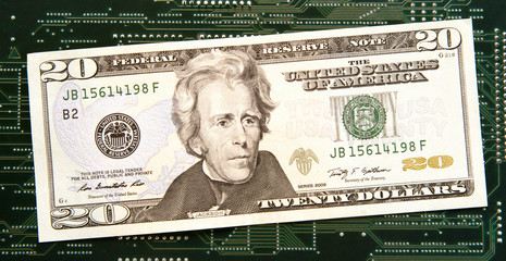 Twenty dollar bill in front of circuit board