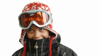 happy child in the ski suit on a white background