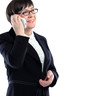 businesswoman in a black suit calling on a cell phone