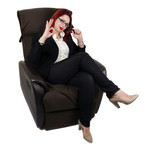 Businesswoman sitting in the armchair with legs crossed
