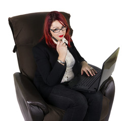 Business woman with laptop and a pen