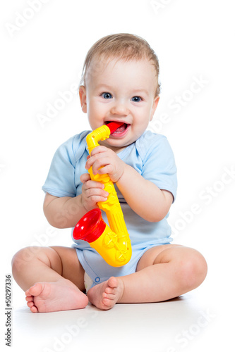 baby playing with musical toy isolated on white background