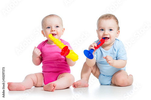 Funny children girl and boy playing with musical toy. Isolated o