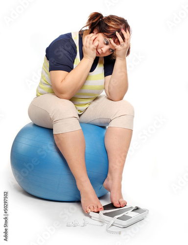 Frustrated overweight woman.