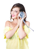 Woman listening with tin can phone to ear