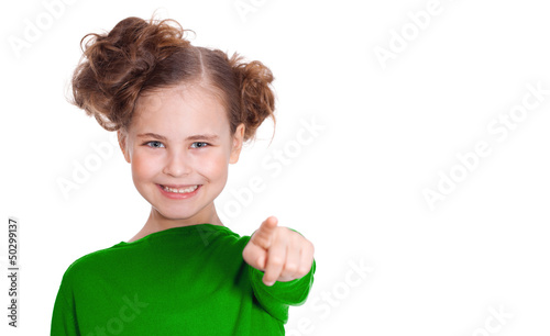 small beautiful girl shows a finger of a hand in a direction of