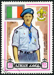 AJMAN - 1971: shows Scout and flag of Italy