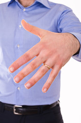 Young man showing his wedding ring.