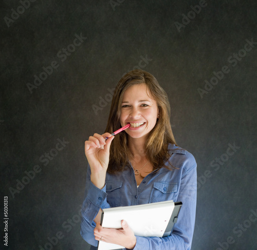 Confident woman with notepad and pen