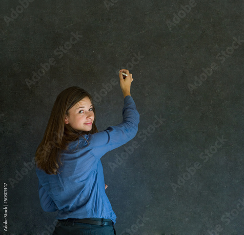 Woman writing on dark blackboard background