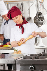 Female Chef Seasoning Salmon Roll