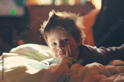 child from sleep lying on the sofa and enjoying life