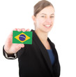 business woman holding a card with the Brazilian flag