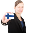business woman holding a card with the Finnish flag