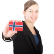 business woman holding a card with the Norwegian flag