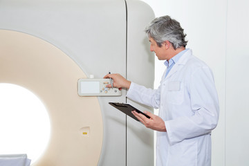 Doctor Operating CT Scan Machine