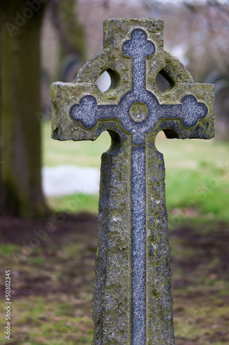 Tombstone - Victorian stone cross in a old cemetery