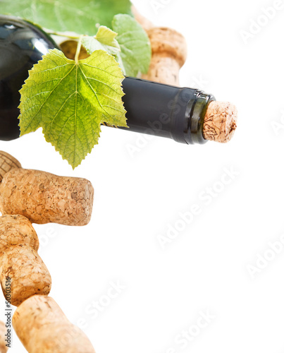 Bottle corks and bottle on the white background