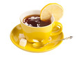 Yellow teacup with sugar and lemon.