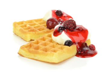 Sponge waffles with fresh cream and red berry sauce