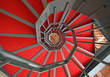 Iron spiral staircase with elegant red carpet and spiral