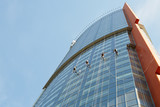 Window cleaners work on high-rise building