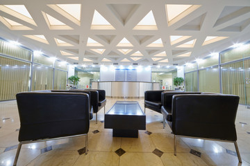 Hall with leather armchairs at business center