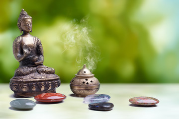 buddha with healing stones