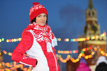 Smiling girl in red at GUM-Skating rink on Red Square in Moscow,