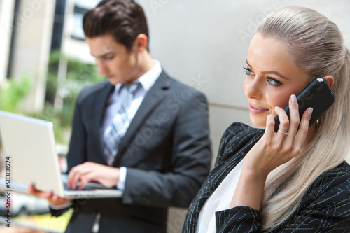 Elegant Businesswoman talking on smart phone.