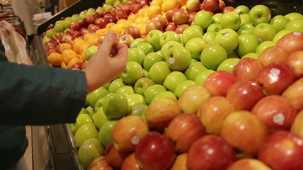 Choosing Green Apples at Organic Grocery store